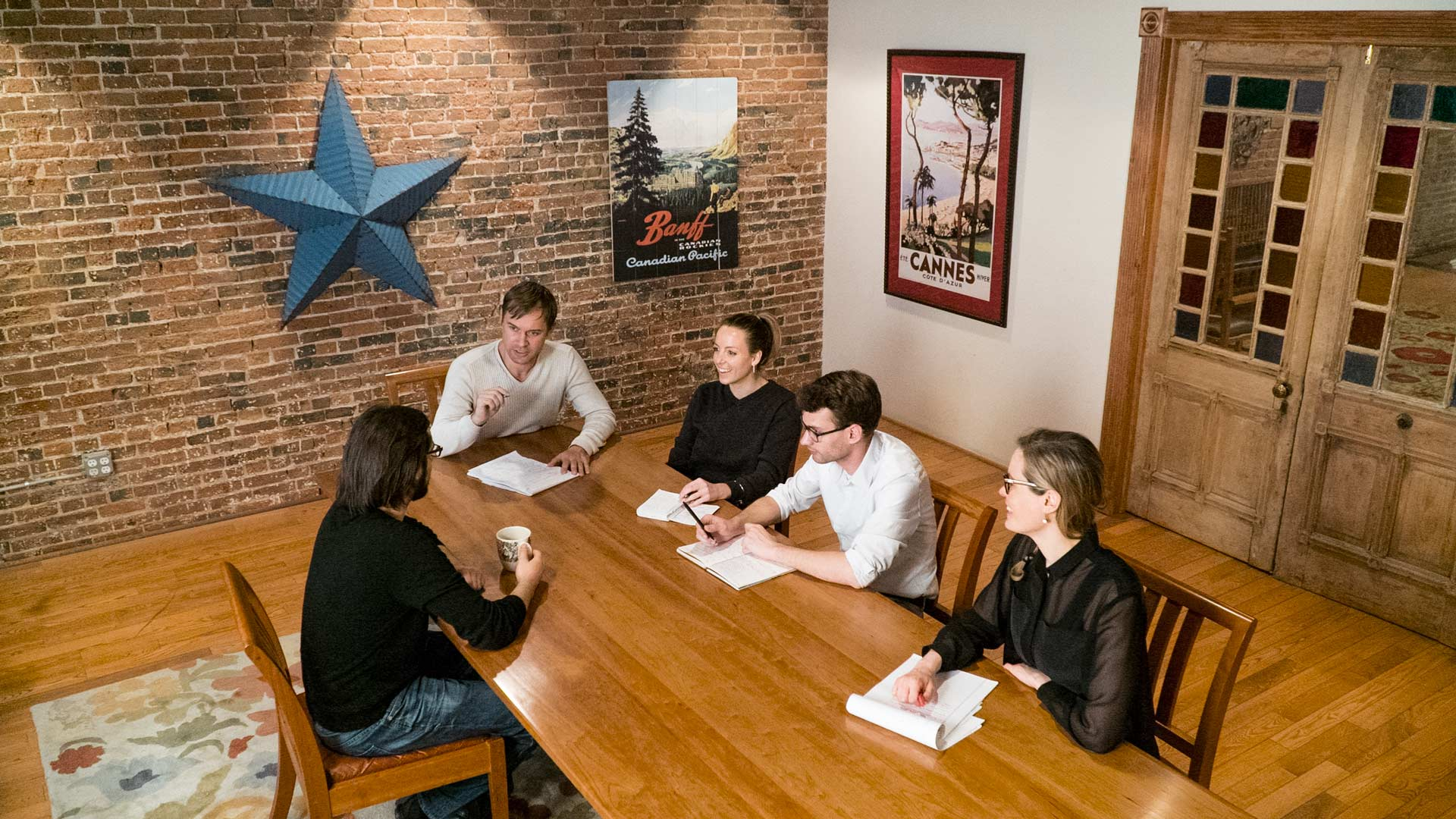 The conference room serves as a  central hub for production meetings